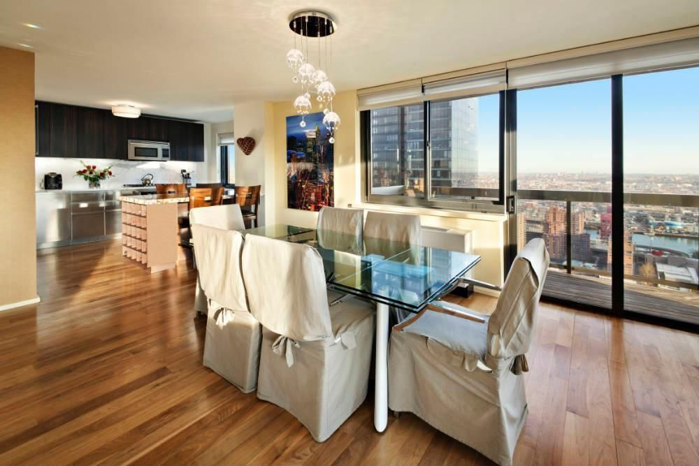 Contemporary Dining Room with Standard height, Hardwood floors, Chandelier, sliding glass door