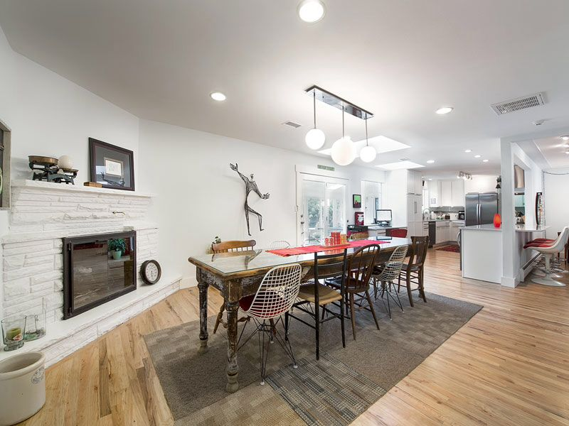 Contemporary Dining Room with Standard height, Fireplace, can lights, Hardwood floors, stone fireplace, French doors