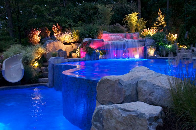 Rustic Swimming Pool with Pool with hot tub, Raised beds