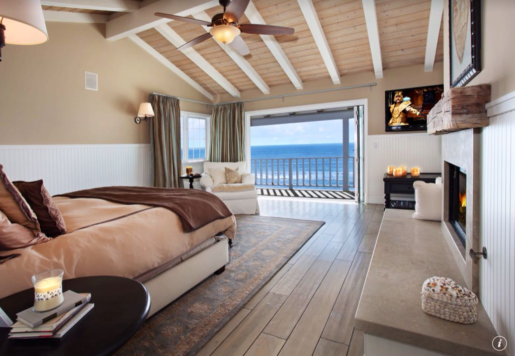 Cottage Master Bedroom with Fireplace, Hardwood floors, Casement, Exposed beam, Wainscotting, High ceiling, Wall sconce