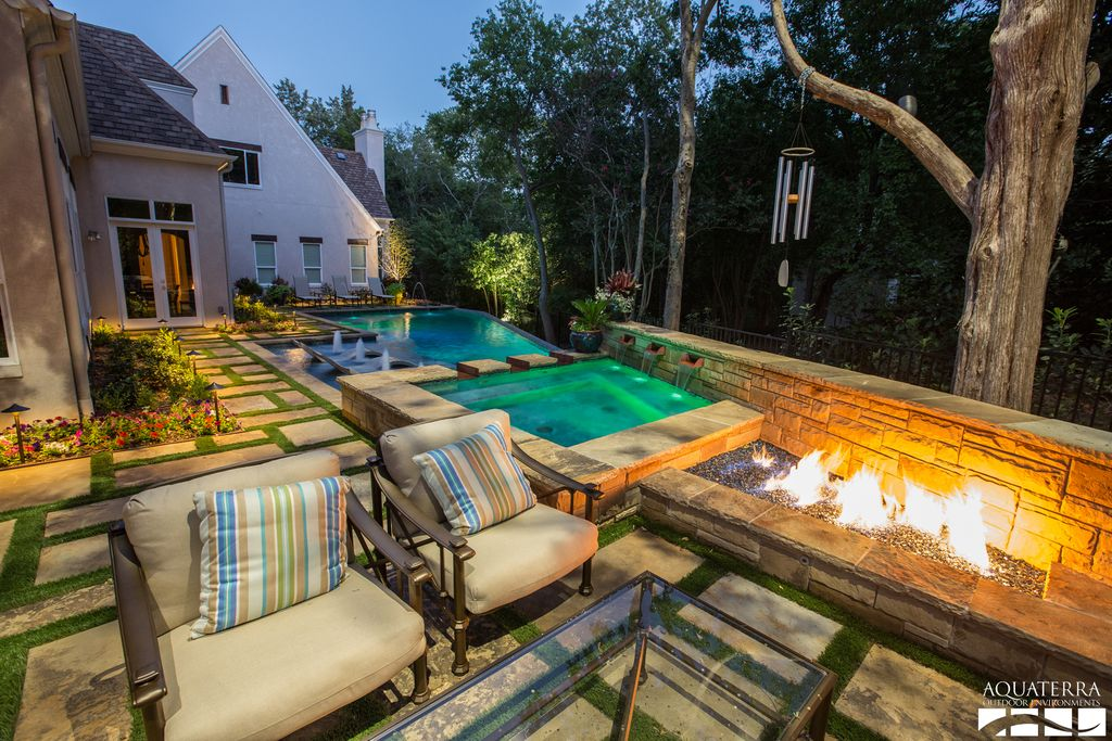 Traditional Patio with French doors, Fire pit, double-hung window, Fence, exterior stone floors