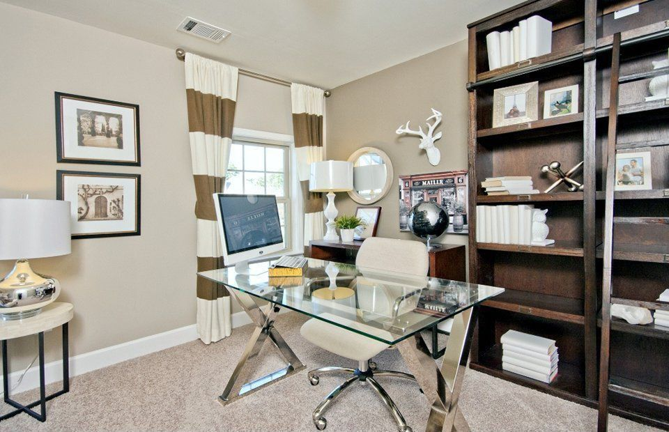 Eclectic Home Office with double-hung window, Standard height, Carpet