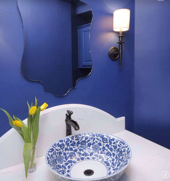Traditional Powder Room with Powder room, Raised panel, Corian counters, Vessel sink, Wall sconce, partial backsplash, Paint