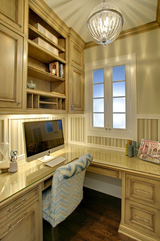 Traditional Home Office with Casement, Built-in bookshelf, Standard height, Crown molding, Window seat, Chandelier