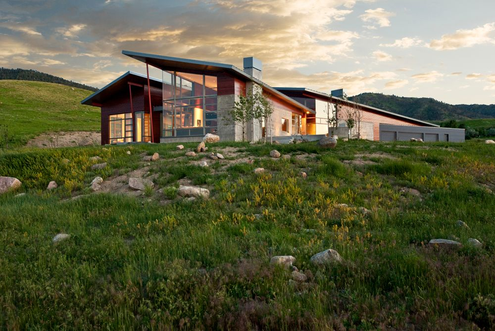 Modern Exterior of Home with Steel, Concrete, Natural light, Wood, Angled roof, High ceiling, Krmpotich residence