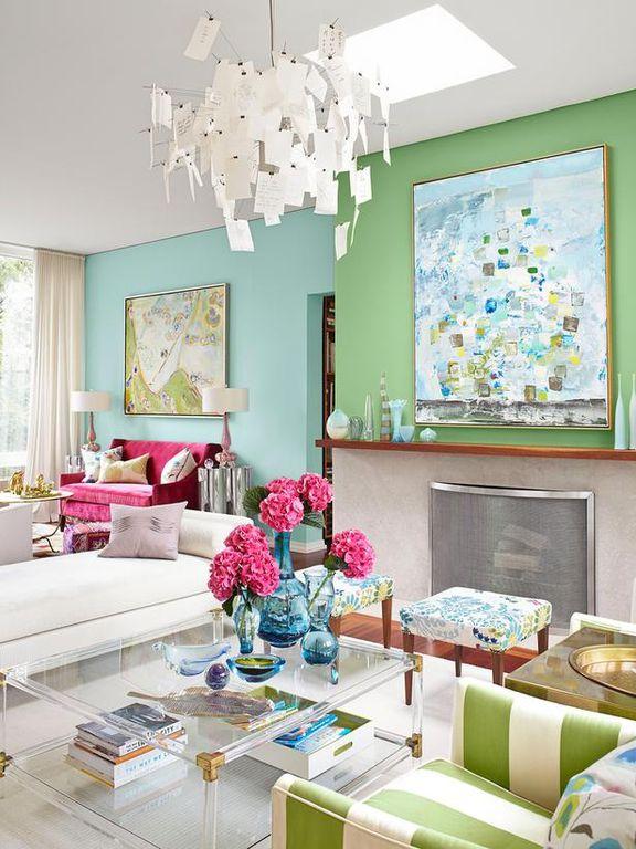 Contemporary Living Room with Hardwood floors, Fireplace, Skylight, Chandelier, Built-in bookshelf, Standard height