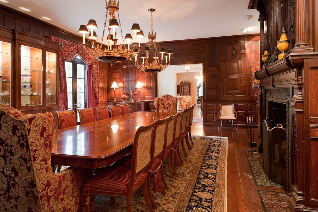 Traditional Dining Room with Fireplace, metal fireplace, French doors, Standard height, Hardwood floors, Built-in bookshelf