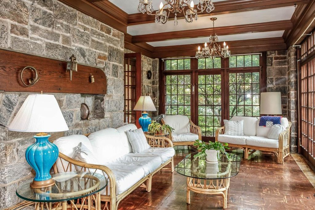 Traditional Living Room with Interior stone wall, Bamboo furniture, Hardwood floors, Exposed beam, Transom window, Chandelier