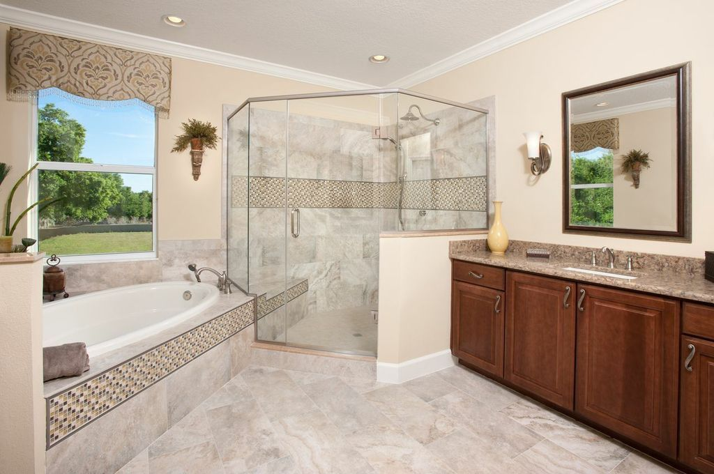 Contemporary Master Bathroom with Handheld showerhead, stone tile floors, drop in bathtub, picture window, Inset cabinets