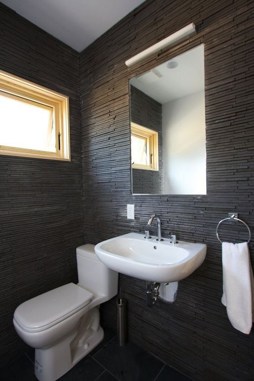 Modern Powder Room with Split face tile, Wall Tiles, Powder room, wall-mounted above mirror bathroom light, can lights