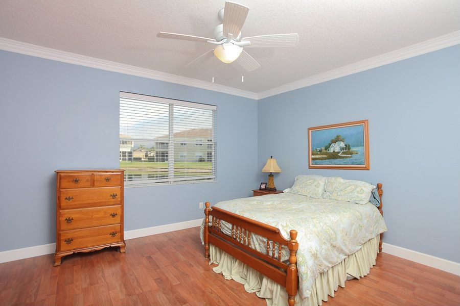 Traditional Guest Bedroom with Standard height, double-hung window, Crown molding, Ceiling fan, Hardwood floors