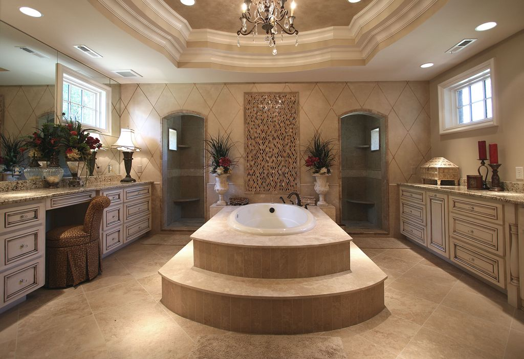 Traditional Master Bathroom with drop in bathtub, Wall Tiles, can lights, Standard height, Casement, stone tile floors