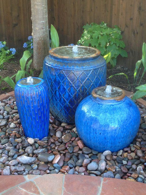 Mediterranean Landscape/Yard with Small ceramic planter, Large ceramic planter, Round ceramic planter