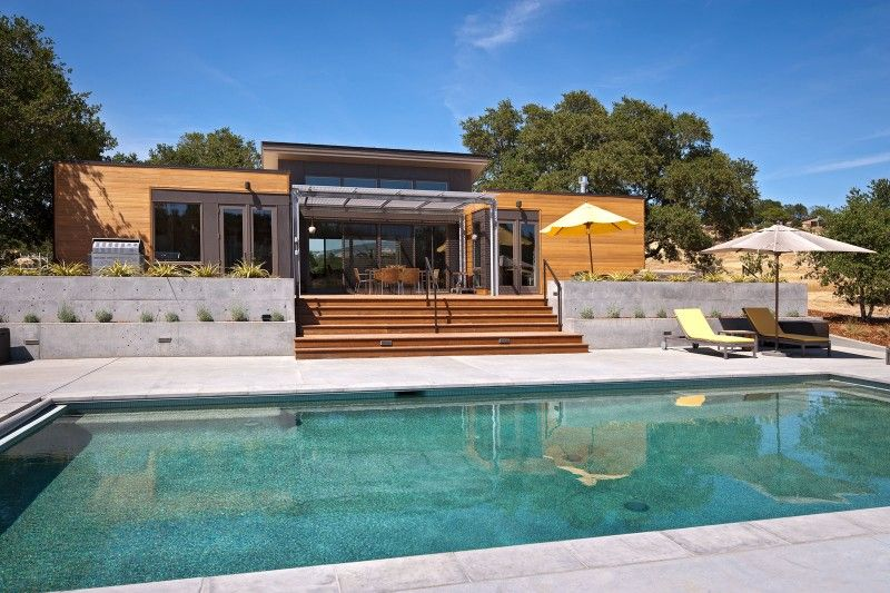 Contemporary Swimming Pool with Raised beds, exterior concrete tile floors, picture window, Fence, exterior tile floors