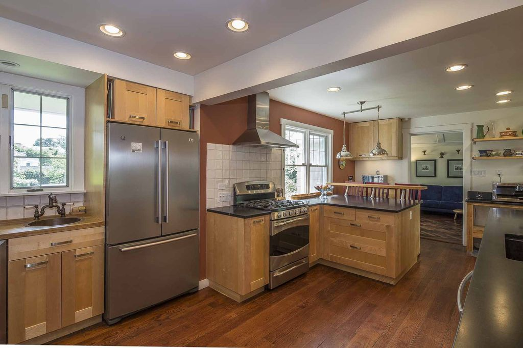 Contemporary Kitchen with Standard height, Large Ceramic Tile, Flat panel cabinets, double-hung window, Undermount sink