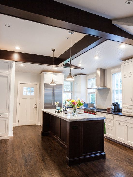 Traditional Kitchen with Inset cabinets, electric cooktop, keurig, Transom window, Kitchen island, Multiple Refrigerators