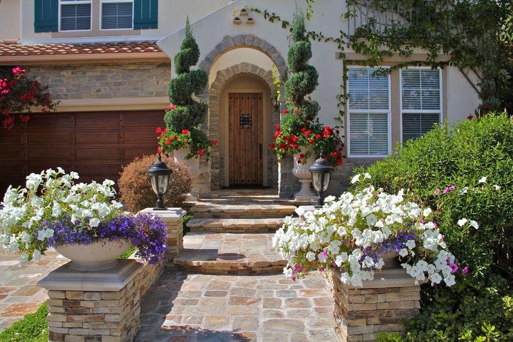 Mediterranean Front Door with double-hung window, Pathway, exterior stone floors