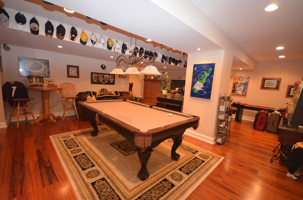 Traditional Game Room with Columns, Furniture of America Woodville Leatherette Loveseat - Dark Brown, Hardwood floors