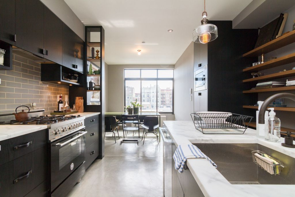 Contemporary Kitchen with flush light, European Cabinets, picture window, Pendant light, Standard height, can lights, Flush