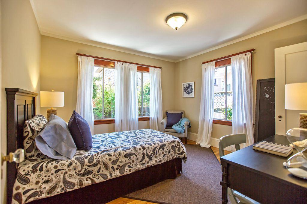 Traditional Guest Bedroom with flush light, Casement, Crown molding, Hardwood floors, Standard height
