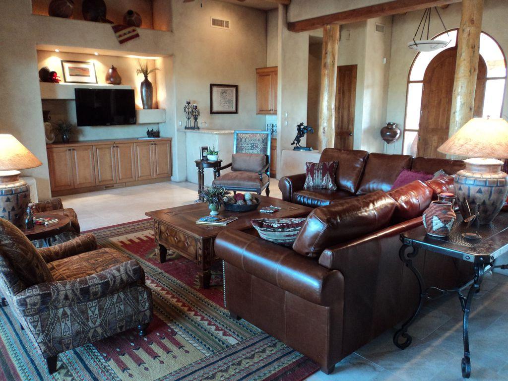 Rustic Living Room with travertine tile floors, High ceiling, Columns, can lights, stone tile floors, Pendant light