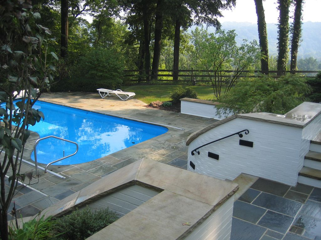 Traditional Swimming Pool with Fence, Other Pool Type, exterior stone floors
