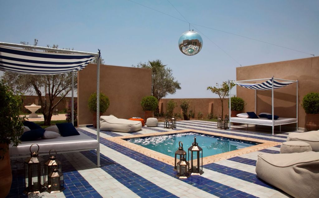 Eclectic Swimming Pool with Fence, exterior stone floors, Fountain, Other Pool Type