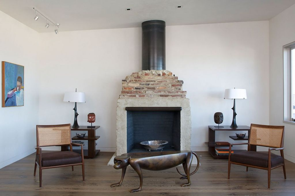 Eclectic Living Room with Fireplace, Standard height, Hardwood floors, can lights, Pendant light, Wood Stove fireplace
