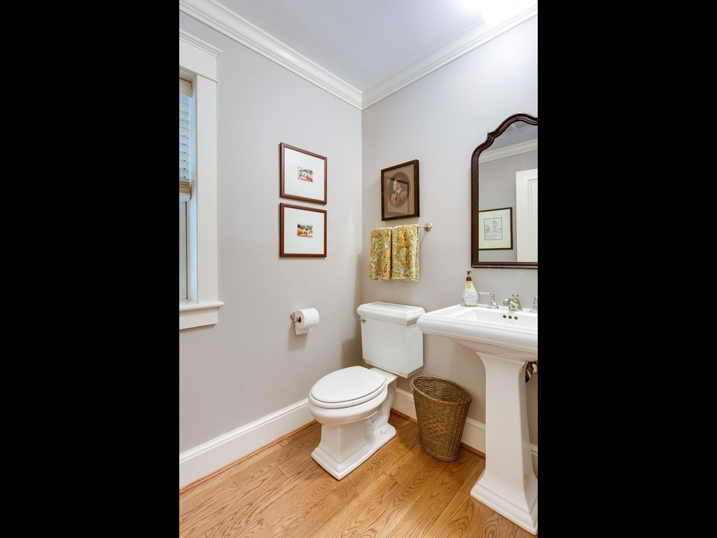 Traditional Powder Room with Crown molding, Powder room, Standard height, Casement, Pedestal sink, Hardwood floors