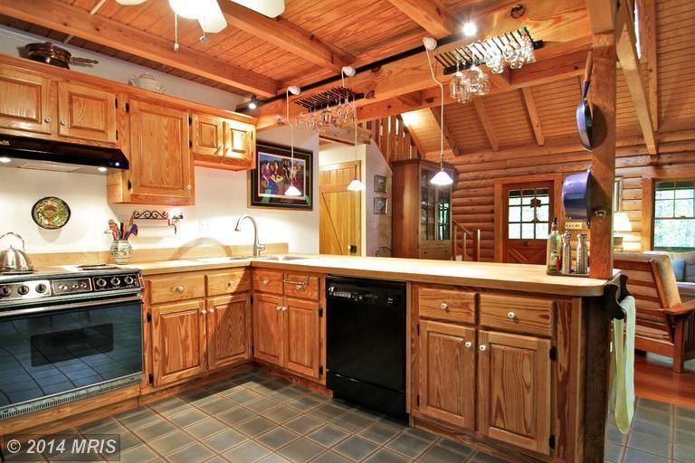 Traditional Kitchen with Standard height, Raised panel, Ceiling fan, flush light, Formica counters, Undermount sink, Paint 1