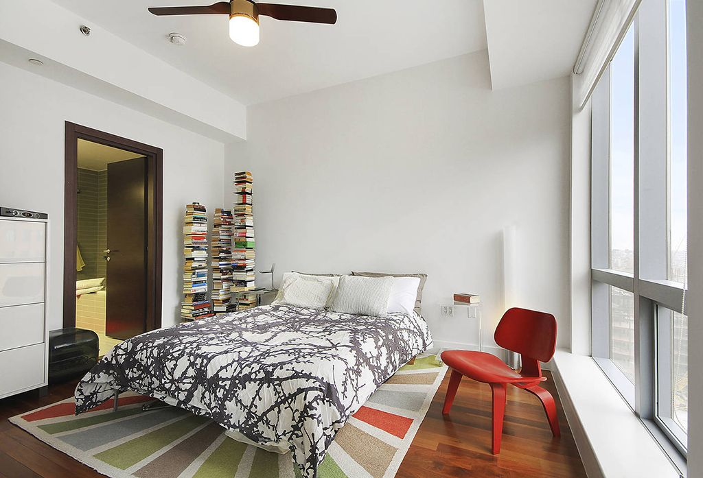 Contemporary Master Bedroom with Ceiling fan, Hardwood floors, flat door, picture window, Standard height