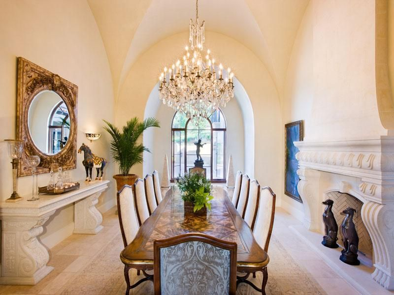 Dining Room with Concrete tile , French doors, High ceiling, Chandelier, Arched window