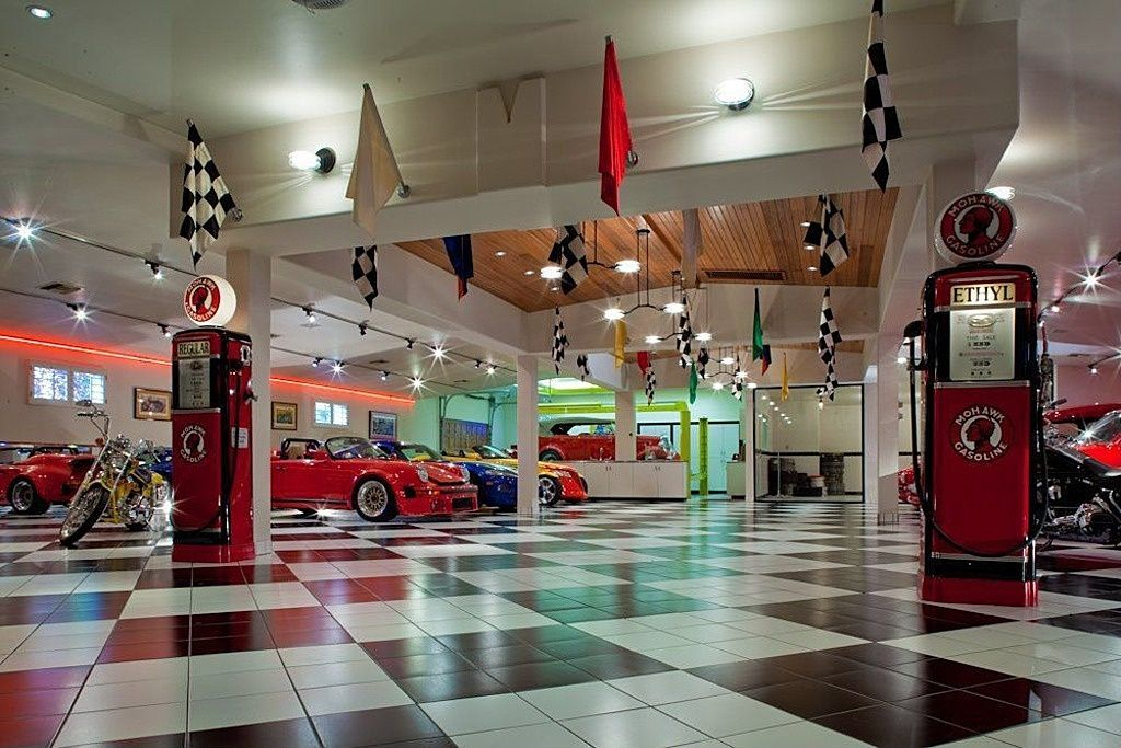 Eclectic Garage with can lights, Wall sconce, Pendant light, Casement, High ceiling, Gas pump cabinet red, Exposed beam