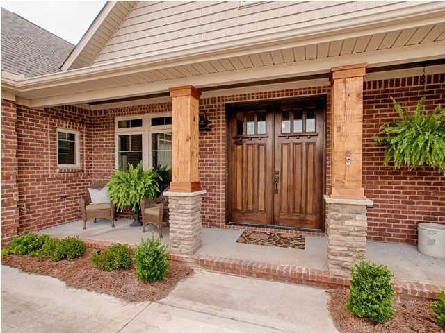 Traditional Front Door with exterior concrete tile floors, double-hung window, Pathway, Glass panel door