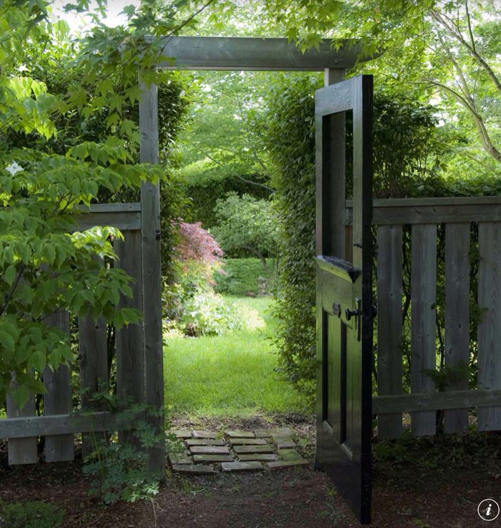 Cottage Landscape/Yard with Wood fence, Brick pathway, Exterior Door