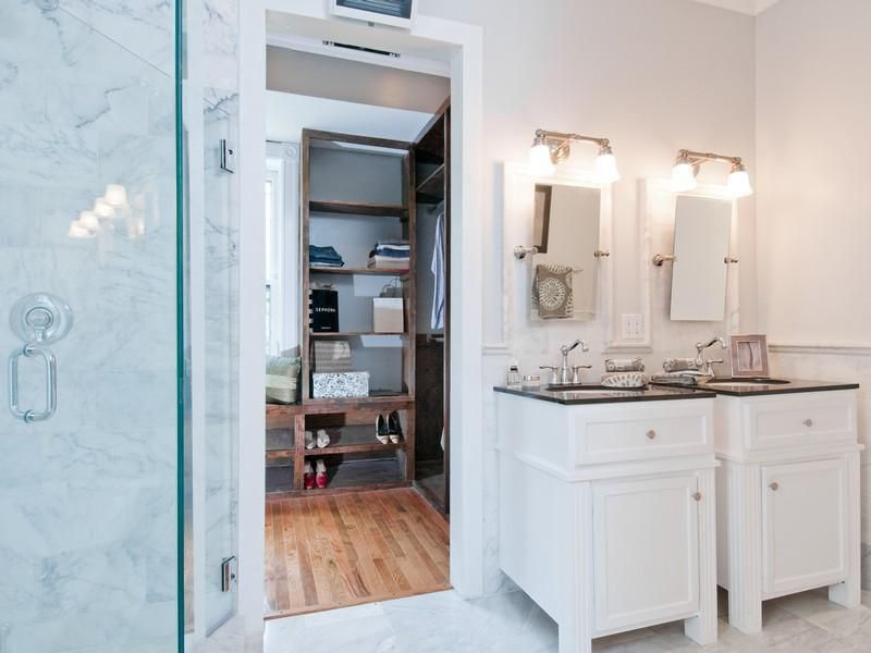 Contemporary room with Chair rail, Wall sconce, Built-in bookshelf, Concrete tile