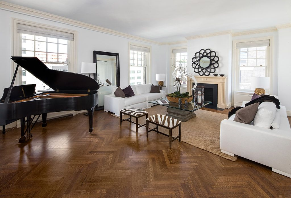 Contemporary Living Room with Standard height, Fireplace, Crown molding, Cement fireplace, Parquet hardwood floor, Area rug