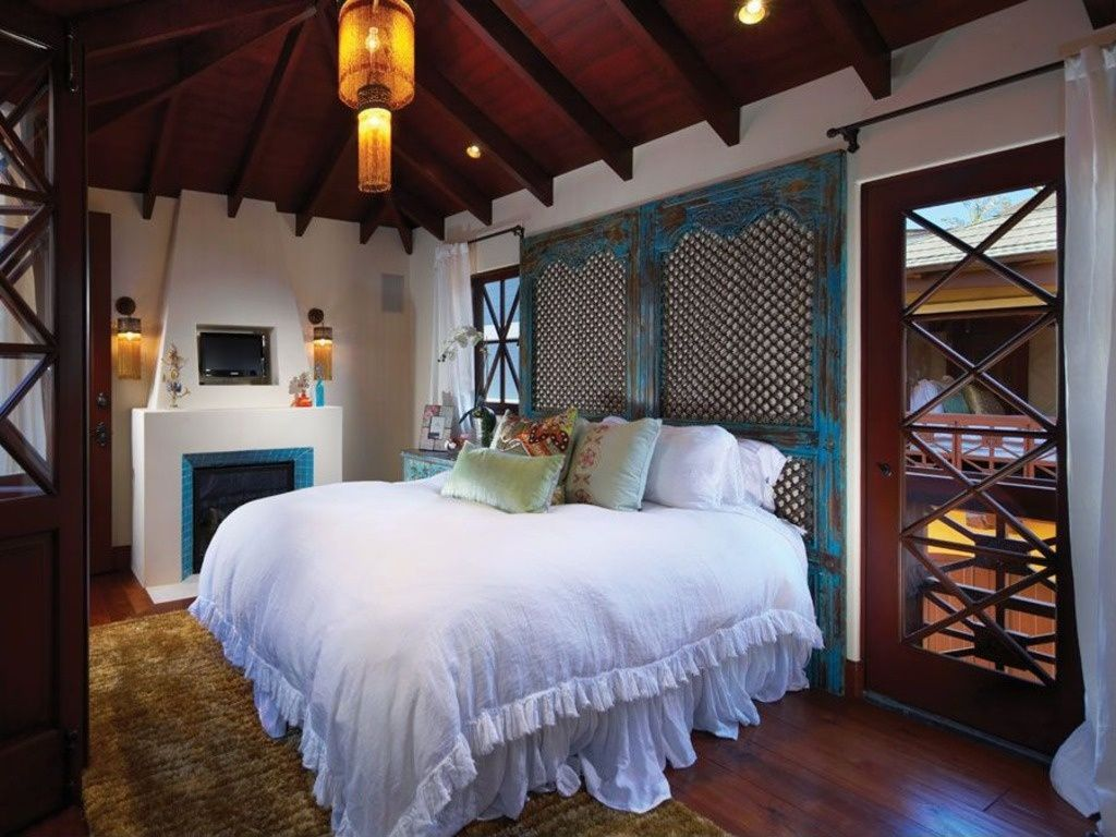 Eclectic Master Bedroom with can lights, Fireplace, High ceiling, French doors, Cement fireplace, Hardwood floors, Casement