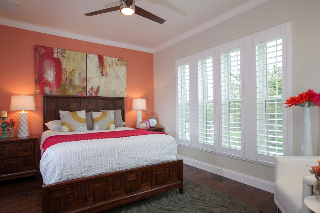 Contemporary Guest Bedroom with can lights, double-hung window, Standard height, Ceiling fan, Crown molding, Hardwood floors