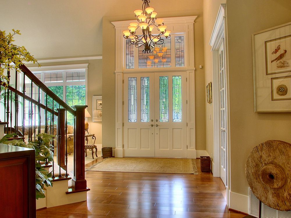 Traditional Entryway with French doors, Hardwood floors, High ceiling, Chandelier, Transom window