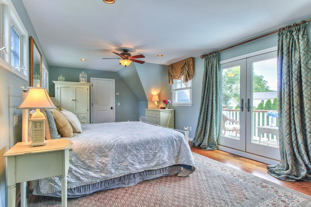 Cottage Guest Bedroom with Casement, Ceiling fan, can lights, Standard height, French doors, flush light, Armoire, Paint
