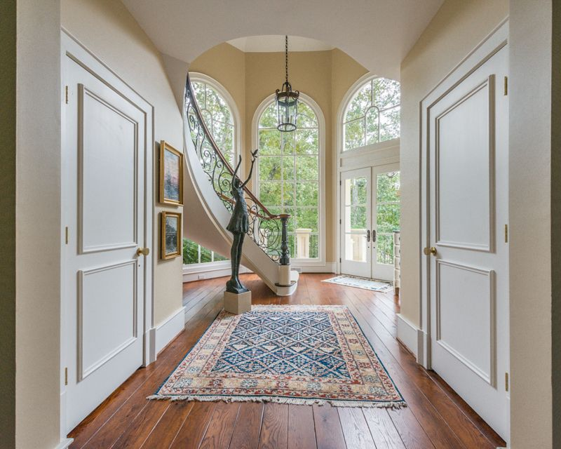 Traditional Entryway with High ceiling, French doors, Pendant light, Hardwood floors, Arched window