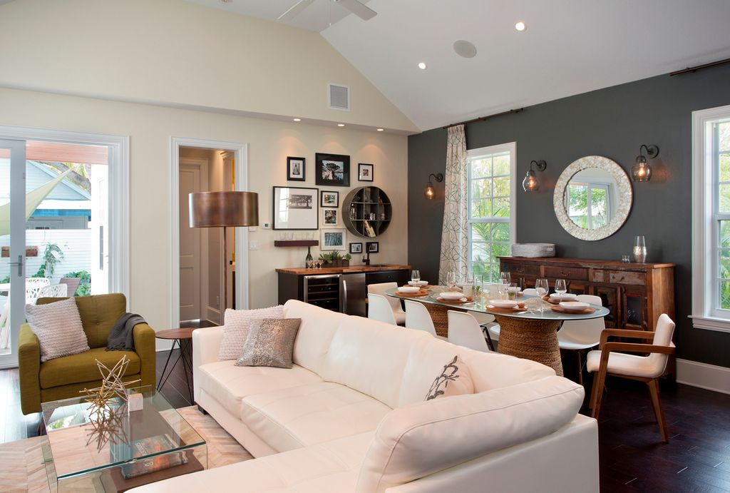 Eclectic Great Room with Hardwood floors, High ceiling, Carpet, Ceiling fan
