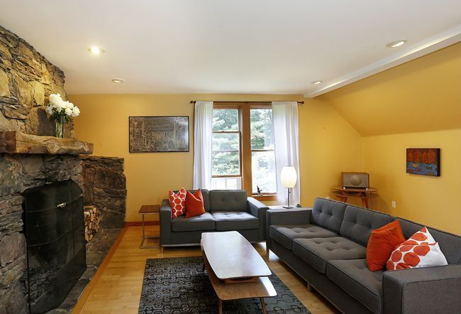 Contemporary Living Room with Fireplace, double-hung window, Hardwood floors, Casement, Exposed beam, metal fireplace, Paint