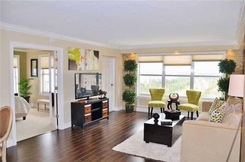 Eclectic room with can lights, double-hung window, Crown molding, specialty door, Hardwood floors, French doors