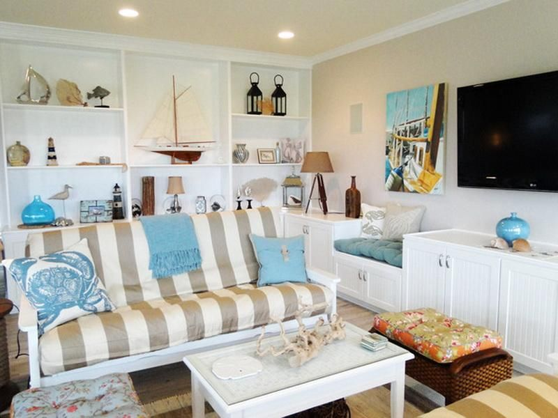 """Cottage Living Room with Hardwood floors, Woodland imports the independent tripod 31"""" h table lamp with empire shade"""