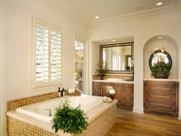 Mediterranean Master Bedroom with Hardwood floors, Built-in bookshelf, Crown molding