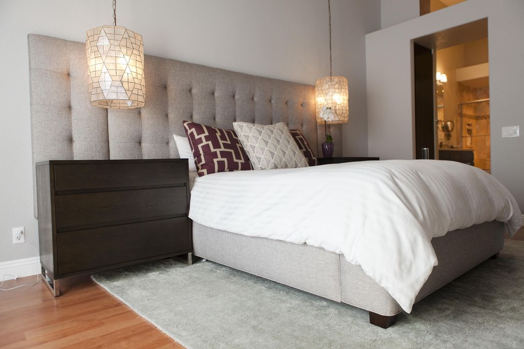 contemporary master bedroom with high ceiling flush light andiamo