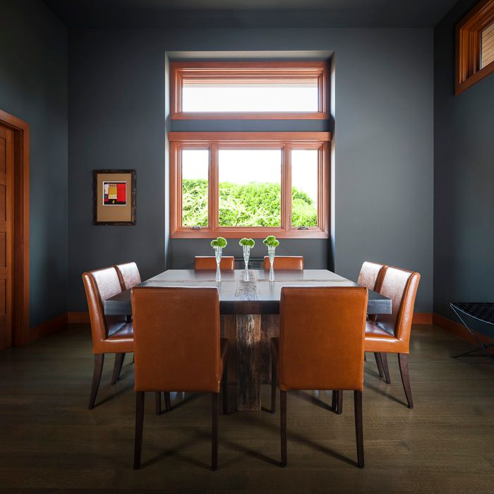Contemporary Dining Room with six panel door, High ceiling, Laminate floors, Casement