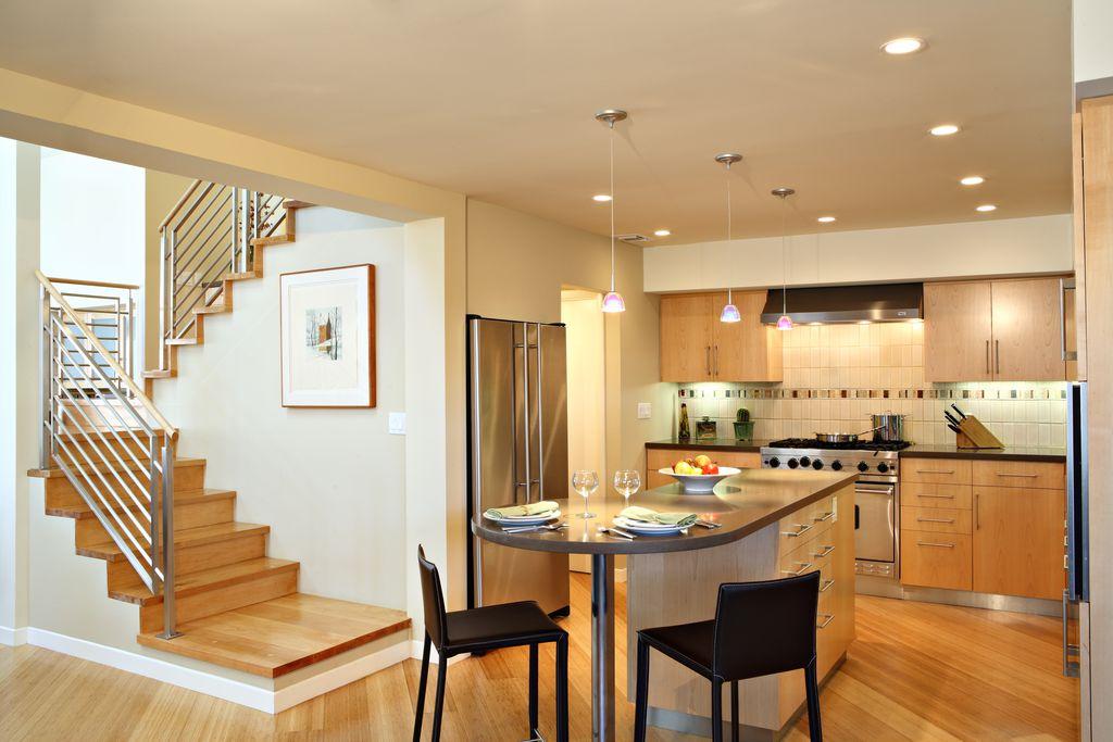 Modern Kitchen with Wall Hood, Pendant light, European Cabinets, Kitchen island, built-in microwave, gas range, Breakfast bar